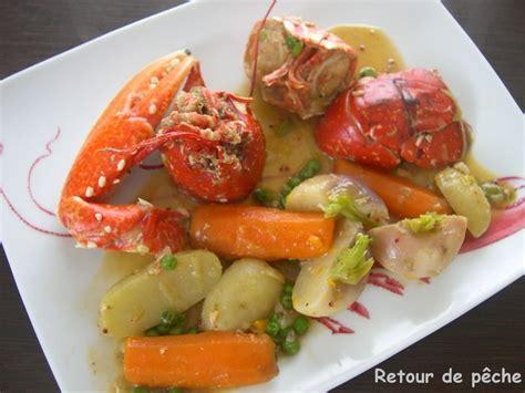 cuisiner le homard vivant homard breton en cocotte aux legumes nouveaux retour de