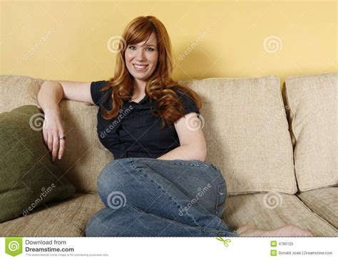 woman couch woman relaxing on couch royalty free stock photo image