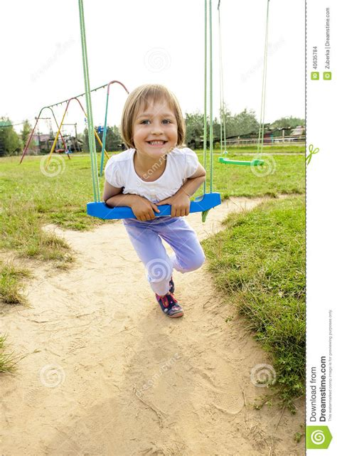 swing years happy on swing stock photo image 40635784