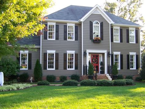 houses with shutters accenting this grey house with black dark shutters is a perfect contrast the shutters really