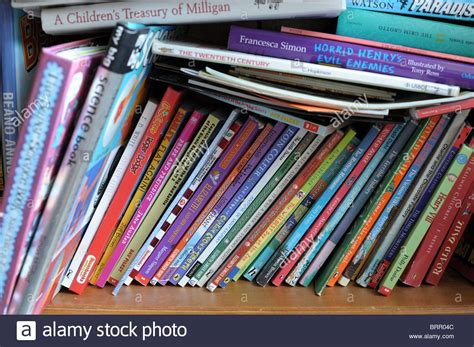 Bookshelf Instructions A Child S Book Case With Books Stacked Up And Shoved On