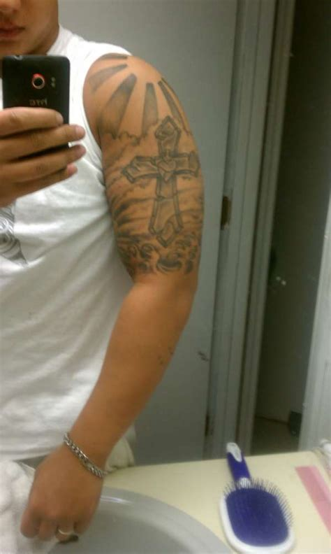 tattoos around a cross cross wut should i add around the cross