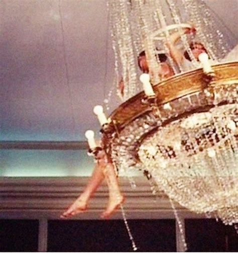 swinging from a chandelier chandelier swinging chandeliers pinterest
