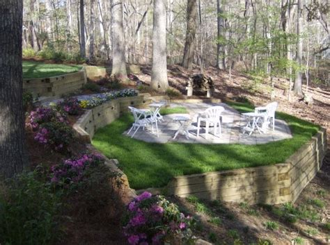 landscaping sloped backyard fire pit sloping yard a few timbers a little dirt a