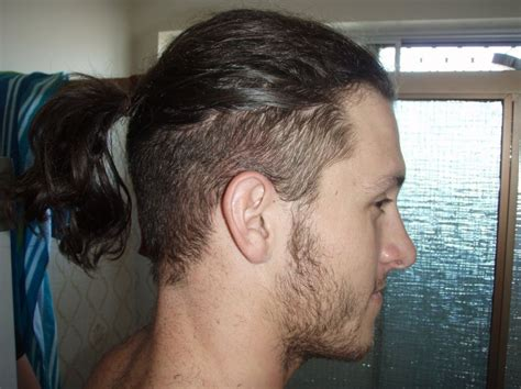 short hair on top and sides poney tail in back long hair top shaved sides men pictures medium hair
