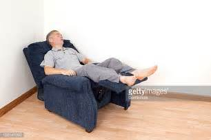 man reclining reclining chair stock photos and pictures getty images