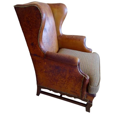 wing chair upholstery much loved antique leather wing chair with upholstered