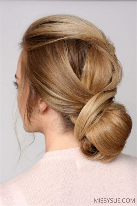 Picture Of sophisticated diy wrapped low bun hair updo 2