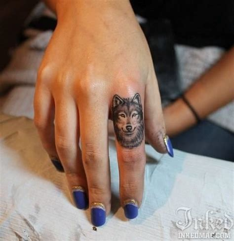 finger tattoo uk cool finger tattoo tattoos pinterest wolves cool