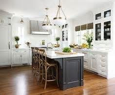 Homestyle Kitchen Island White Kitchen Cabinetry With Grey Accent Island Chrome