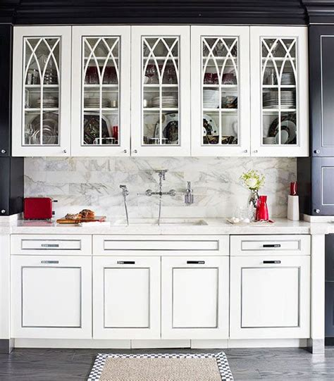 upper kitchen cabinets with glass doors door details intersecting gothic arch muntins give the