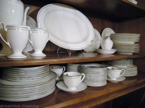 How To Organize Dishes In Cabinets by How To Arrange A China Cabinet Heartworkorg China