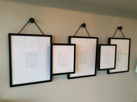 how to hang up a picture frame without nails picture frame hangers haz hanging pictures with ribbon