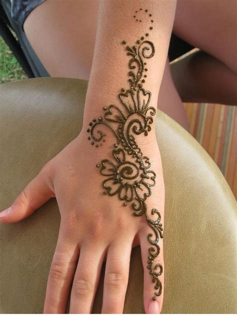 henna tattoo on hand and left arm