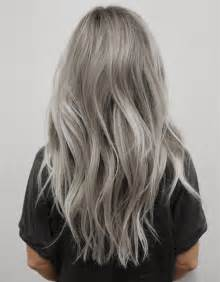 Light gray hair color with silver highlight this balayage hairstyle