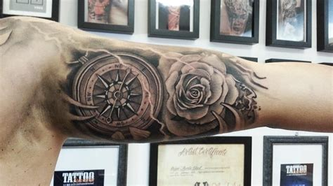 dotwork rose compass tattoo on left arm by daniel rozo very stylish compass rose tattoo creative and stylish