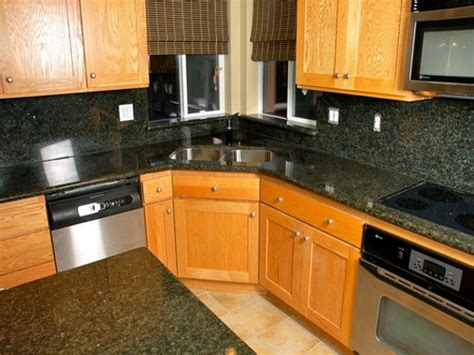 oak and black kitchen cabinets ivory oak kitchen cabinet with black granite counter tops