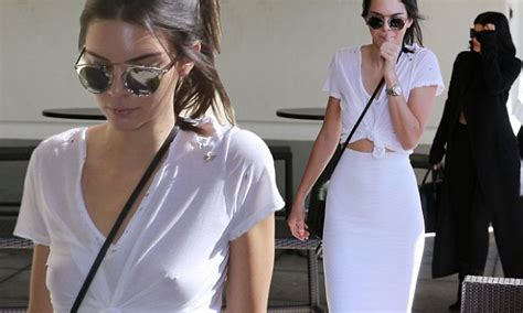 kendall jenner braless with piercing on display at