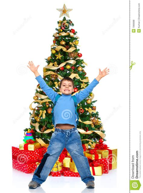 boy and a christmas tree royalty free stock photos image