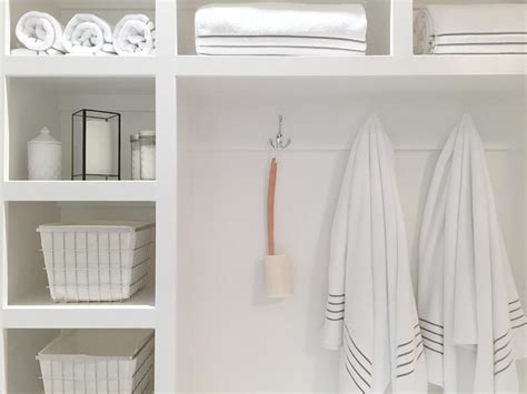 white towel hooks for bathrooms cottage bathroom with built in shelves and vintage metal