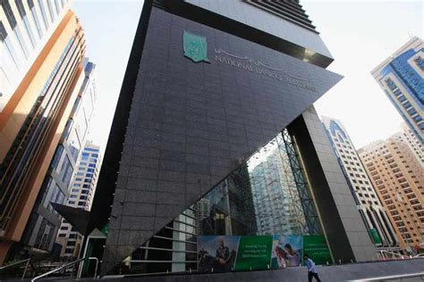 nbad bank branches newly merged abu dhabi bank s shares rise in debut