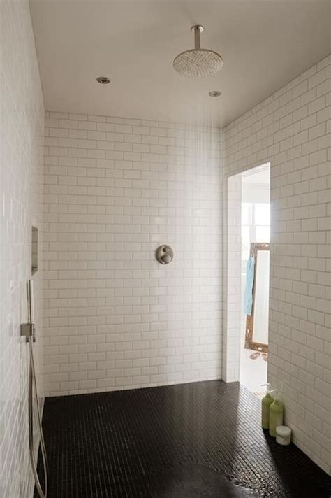 Large Tiles In Small Room by Black And White Shower With Brass Gooseneck Shower