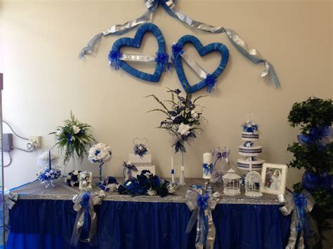 Royal Blue, Silver and White: bows, candle embellishments