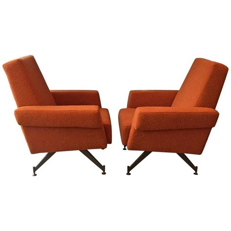 pair of vintage mid century orange lounge chairs 1950s