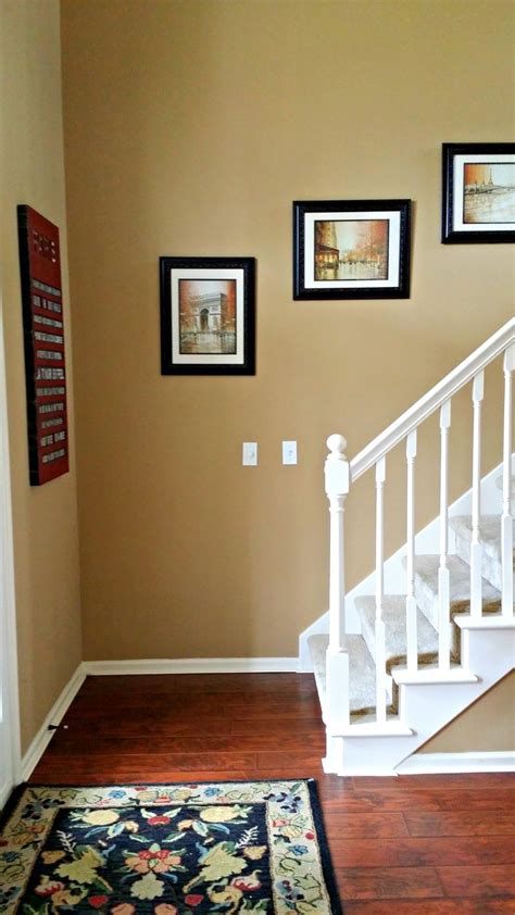 benjamin moore spice gold walls cherry floors white trim