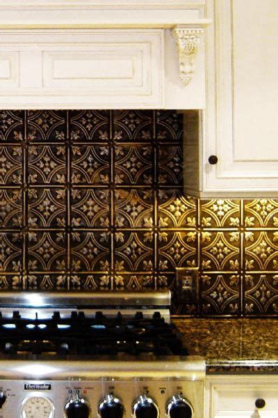 bronze backsplash white cabinets rubbed bronze hardware