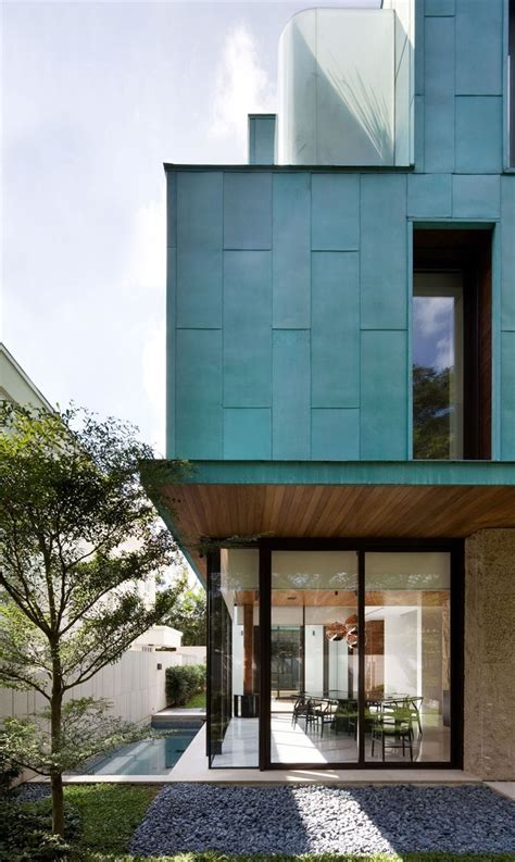 modern green house metallic exterior meets modern interiors at singapore s