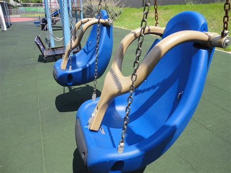 swing for handicapped child improved playgrounds and ball fields allow disabled kids