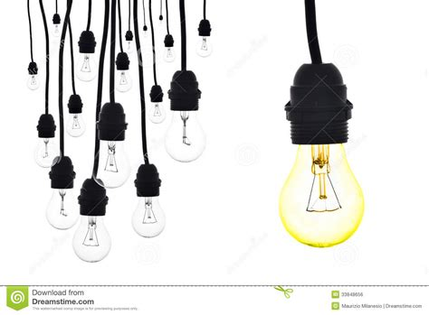 a yellow light bulb hanging next to a number of ls