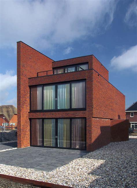brick wall house boasts minimalist style  maximum appeal