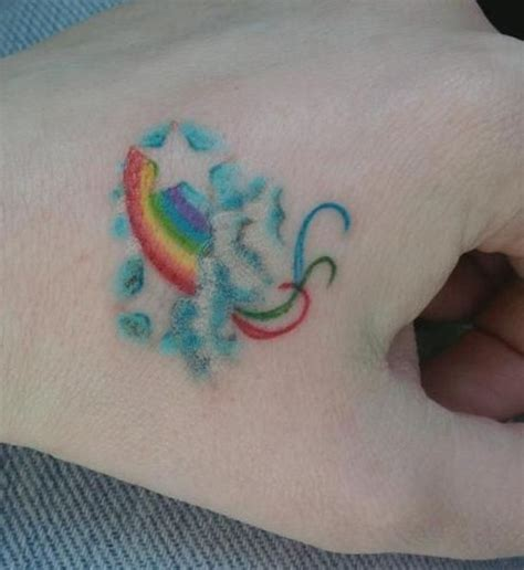 tatto when it rains look for rainbows when it s dark follow the trend rainbow tattoo design as your choice