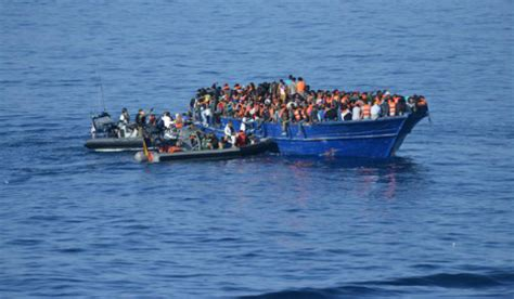 refugee boat italy spain spanish navy ship rescues over 500 refugees from fishing