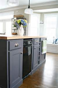 gray kitchen island painted with peppercorn from sherwin williams butcher block counter