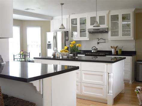 glossy with white kitchen cabinets with black granite and