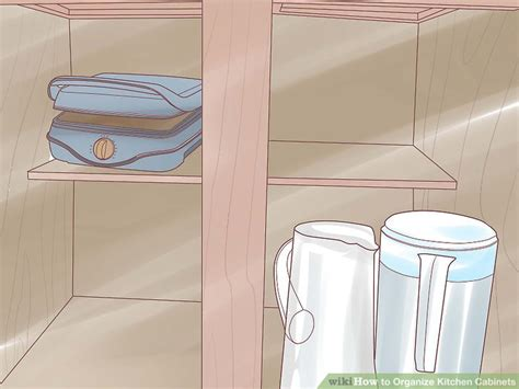 steps for organizing kitchen cabinets how to organize kitchen cabinets 15 steps with pictures