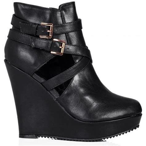 buy lifestyle heeled cut out platform ankle boots black