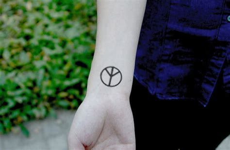 peace tattoo wrist 36 classic peace symbol wrist tattoos design