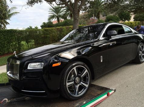 roll royce ross rick ross throws some wheels on his wraith celebrity