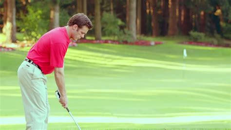 smooth swing golf man tees off on golf course stock footage video 4679465