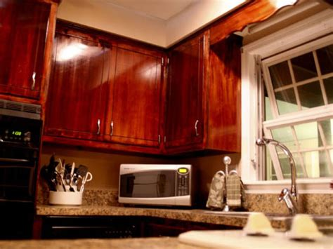 staining kitchen cabinets darker before and after how to give your kitchen cabinets a makeover hgtv