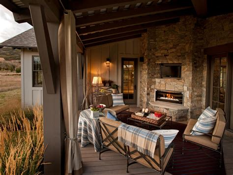 life room outdoor living rustic deck with stone fireplace hgtv