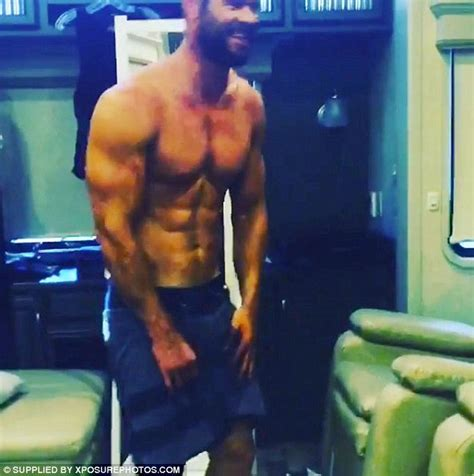 chris hemsworth reveals muscles and chiselled abs in