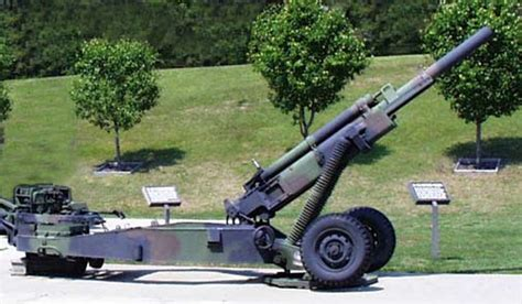 M102 L by M102 105mm Howitzer