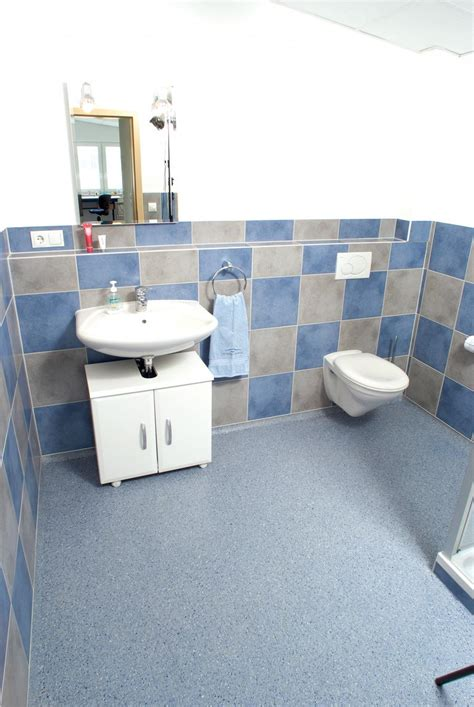 Bathroom Floorings by Commercial Restroom Photography