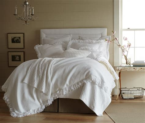 white shabby chic bedding in a neutral room