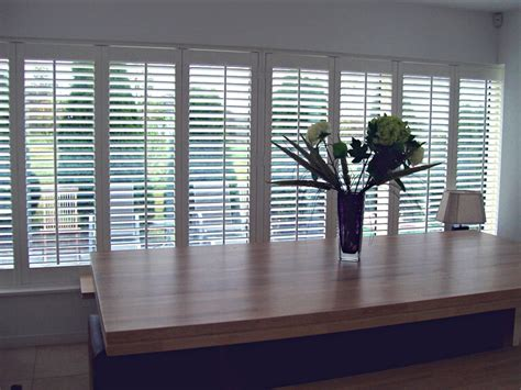 plantation shutters add a touch of luxury elegance to